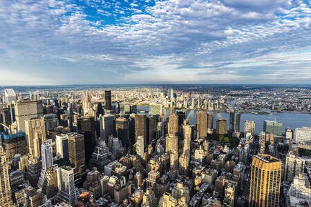 Photo for Elevated view of the skyline of modern skyscrapers of Manhattan at sunset in New York City, USA - Royalty Free Image