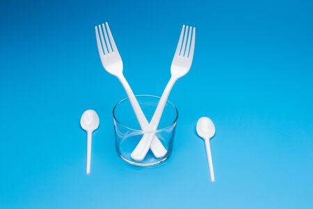 Cutlery for eating white and made of plastic and transparent glass cups; Cutlery and glasses teaspoons for coffee and for rationing small amounts of sugar, fork for pricking food, glasses for drinking