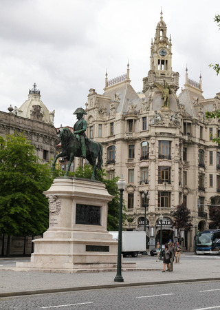PORTO, PORTUGAL - JUNE 4, 2014: Statue of Don Pedro I (1798-1834), nicknamed the Liberator, founder and first ruler of the Empire of Brazil. He reigned briefly over Portugal as King Pedro IV and this statue is in the center of Porto, Portugal.