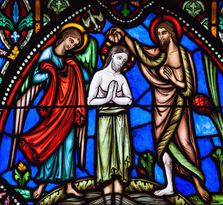 BRUSSELS, BELGIUM - JULY 26, 2012: Stained Glass window of Jesus' baptism in the river Jordan by Saint John the Baptist, in the Cathedral of Brussels, Belgium.