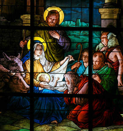 Foto de Nativity Scene at Christmas. Stained glass window in the German Church in Gamla Stan in Stockholm. - Imagen libre de derechos