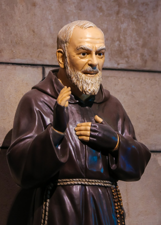 Statue of Padre Pio, also known as Saint Pio of Pietrelcina, in Monaco Cathedral.