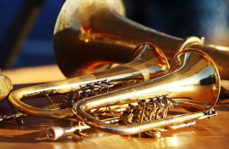 Photo pour Blowing brass wind instrument on table - image libre de droit