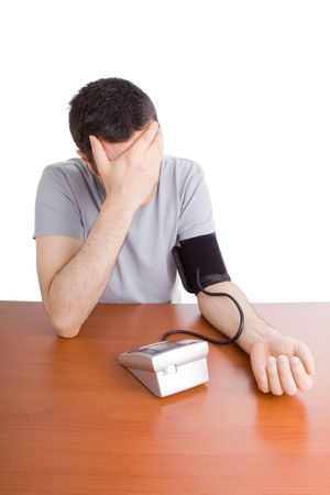 Man feeling sick checking his blood pressure