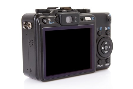 back of black digital compact camera isolated on white
