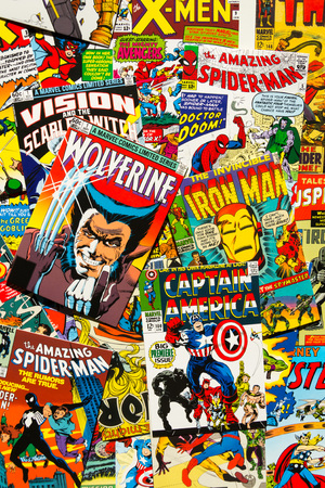 PRAGUE, CZECH REPUBLIC - JANUARY 29: Colorful vintage comic magazine covers top view flat lay composition on January 29, 2018 in Prague, Czech Republic.