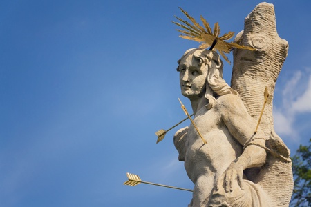 Saint Sebastian shot with arrows martyr statue, Marian plague column of Saint Rosalia, Velehrad Monastery, Moravia, Czech Republic, sunny day clear blue sky