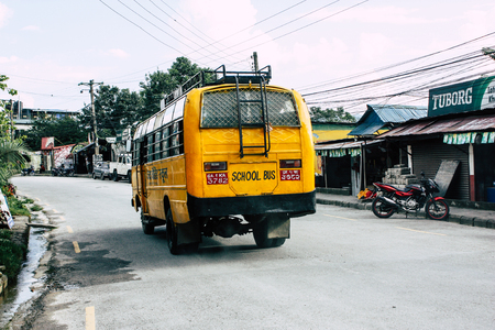 Pokhara Nepal September 18, 2018 View of a traditional yellow school bus rolling in Pokhara in the morning