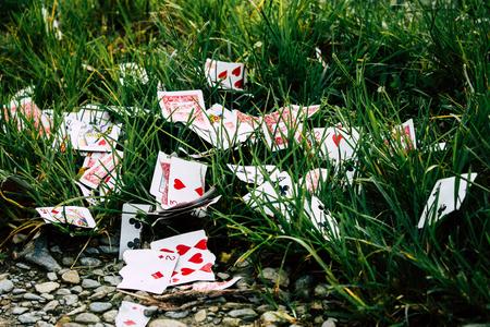 Kathmandu Nepal September 27, 2018 Close-up of a torn card game thrown in the grass by the roadside in Kathmandu