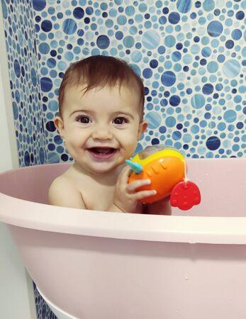Photo pour Baby having a bath indoor - image libre de droit