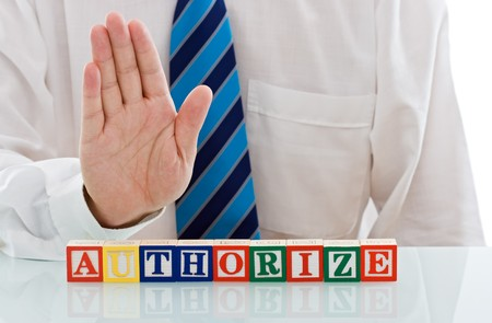 Businessman's palm above of authorize word, limited entering zone