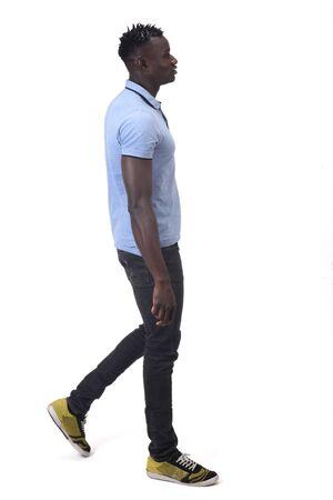 Photo pour african man walking on white background - image libre de droit
