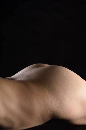 Foto de curves of a woman lying on black background - Imagen libre de derechos