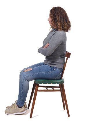 Photo pour portrait of a woman sitting on a chair in white background, - image libre de droit