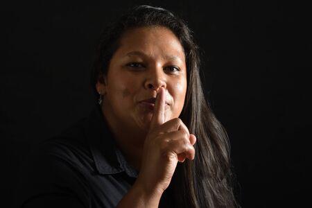 Photo pour woman with silence sign on black - image libre de droit