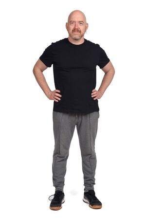 Photo pour man with sportswear and hands on hip on white background - image libre de droit