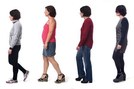 Photo pour woman dressed in different outfits like sportswear, blue jeans, dress and skirt walking on white background - image libre de droit