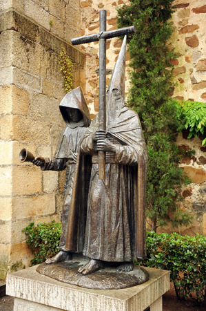 Nazarenes with cross, bronze sculpture, Holy Week in Caceres, Extremadura, Spain