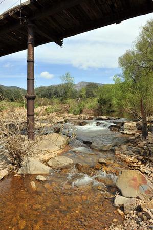 Broken bridge, Robledillo river, landscape of Sierra Morena, Province of Ciudad Real, Castilla la Mancha, Spain