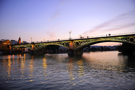 The famous Triana bridge at sunset, Seville, Andalusia, Spain, Europe