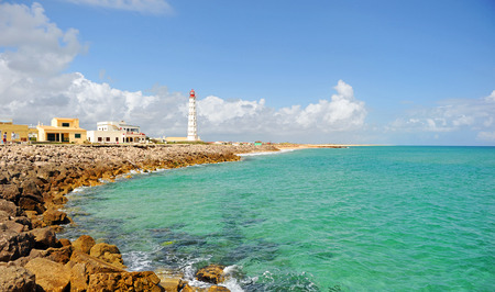 Lighthouse on the island Culatra, Algarve, southern Portugal, Europe