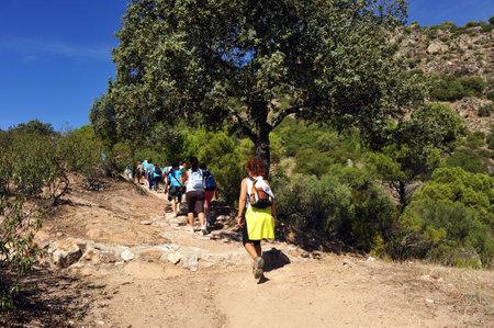 Group of women hikers in the Sierra de Andujar Natural Park, Sierra Morena, province of Jaen, Spain