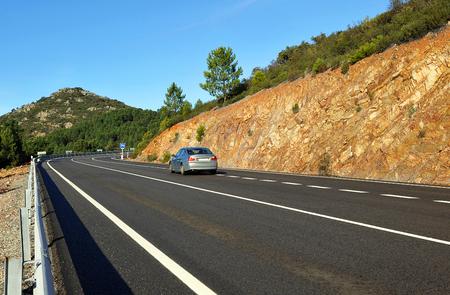 Car on the road, mountain pass of Niefla, Ciudad Real province, Castilla la Mnacha, Spain
