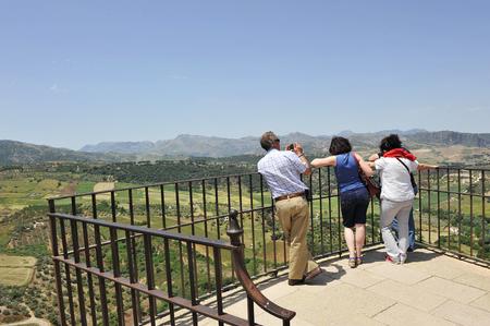 Three people on the lookout over the Tajo de Ronda, Malaga province, Spain