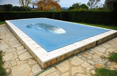 Pool with a tarp for protection in winter