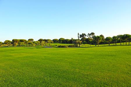Playing golf, El Rompido, Huelva province, Andalusia, Spain