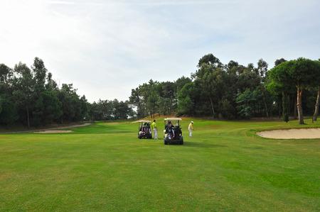 Players on the golf course, Islantilla, Huelva province, Spain