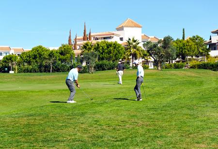 Group of friends playing golf, El Rompido, Huelva, Spain