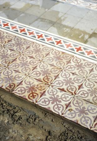 Placing a cement floor tiles, vintage decoration