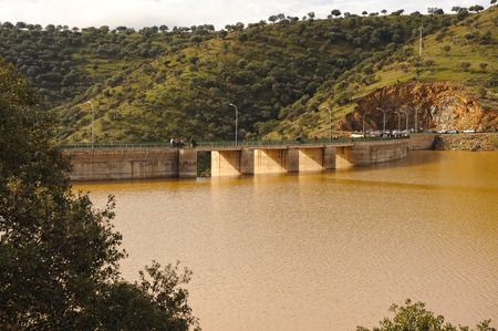 Full reservoir after the autumn and winter rains, dam of Montoro, Ciudad Real province, Spain