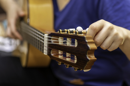 Photo for Tuning guitar. - Royalty Free Image