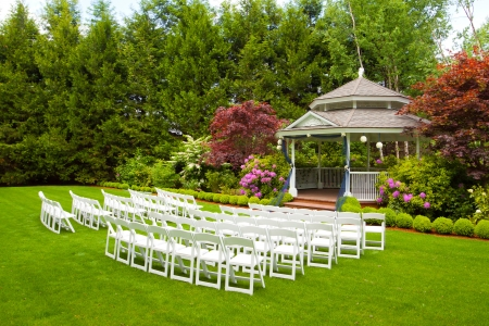 A gazebo and white chairs at a wedding venue for the ceremony and reception