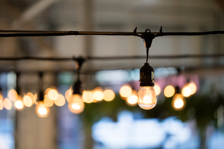 String lights lighting a wedding reception in the Winter in Oregon.