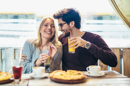 Photo for Smiling couple enjoying in pizza, having fun together. - Royalty Free Image