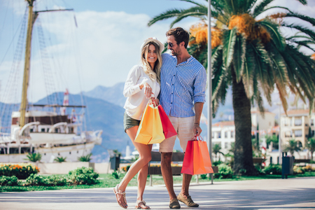 Photo for Couple having fun outdoor while doing shopping together - Royalty Free Image