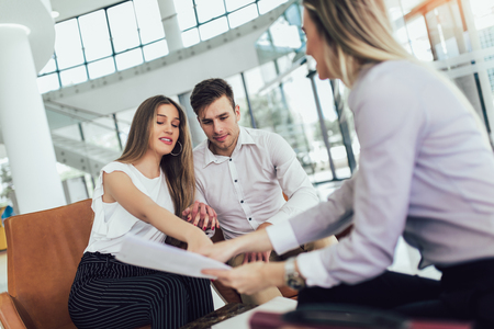 Photo pour Financial advisor showing report to young couple for their investment. Salesman and positive couple talking about purchase. Happy couple consulting financial agent for loan. - image libre de droit