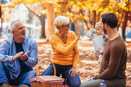 Photo pour Multl generation family in autumn park having fun - image libre de droit