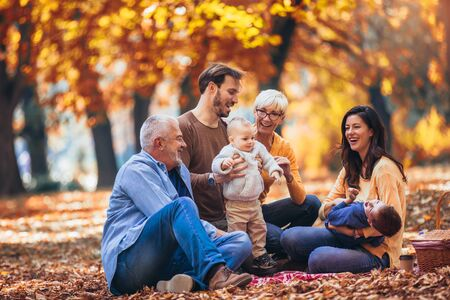 Foto de Multl generation family in autumn park having fun - Imagen libre de derechos