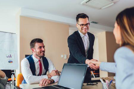 Photo pour Business shaking hand with a client in office - image libre de droit