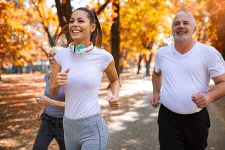 Photo pour Senior man and woman and young female instructor  workout on fresh air. Outdoor activities, healthy lifestyle, strong bodies, fit figures. Stylish, modern sportswear. - image libre de droit