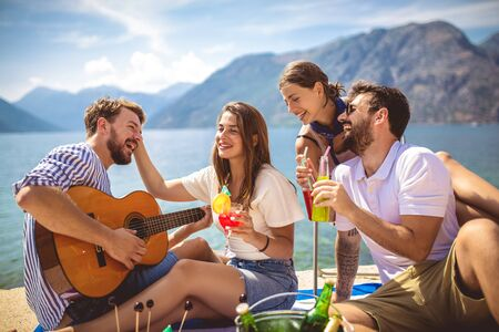 Photo for Young people having fun on summer vacation.Happy friends drinking tropical cocktails on the beach. - Royalty Free Image