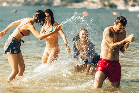 Photo for Happy friends having fun on beach - Royalty Free Image