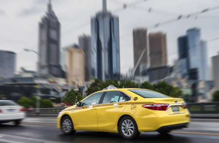 Fast moving taxi in Downtown Melbourne, Australia.