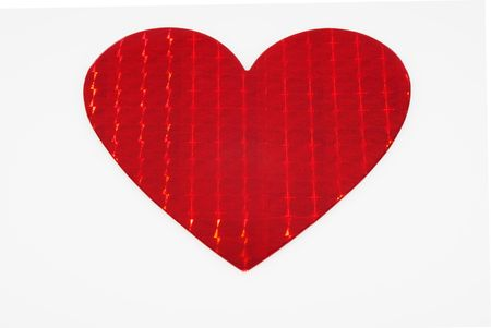 This is one big shiny metallic red heart isolated on a white background.  Great for everyday use or Valentine's Day.の写真素材