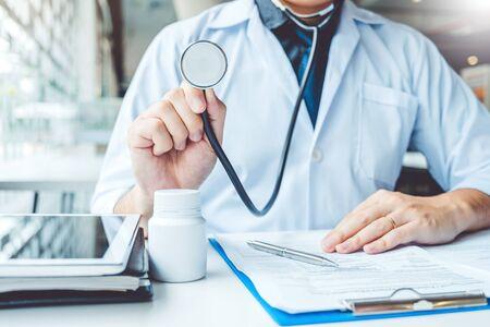 Photo pour Doctor holding a stethoscope blood pressure man patient Health care in hospital - image libre de droit