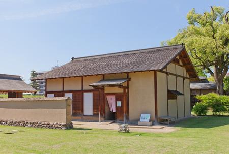 MATSUYAMA, JAPAN - MAY 21, 2015: First of two reconstructed samurai houses (Buke Yashiki) on the grounds of former Yuzuki castle in Dogo Park of Matsuyama, Shikoku, Japan. Yuzuki castle was erected in 1338, abandoned in XVI c.